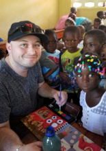 Colin with children of Haiti